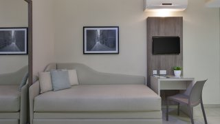 Studio 115 The Strand Hotel and Suites
